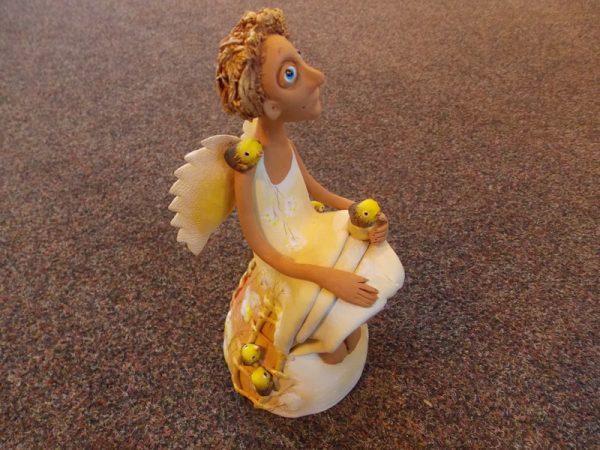 Ангел с птицами