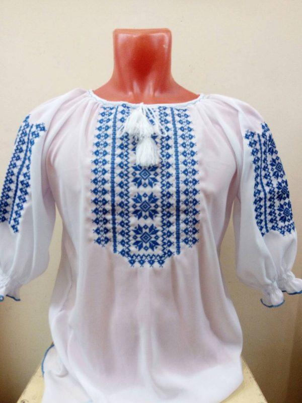 Вышиванка. Женская блузка с голубым орнаментом и солярным знаком